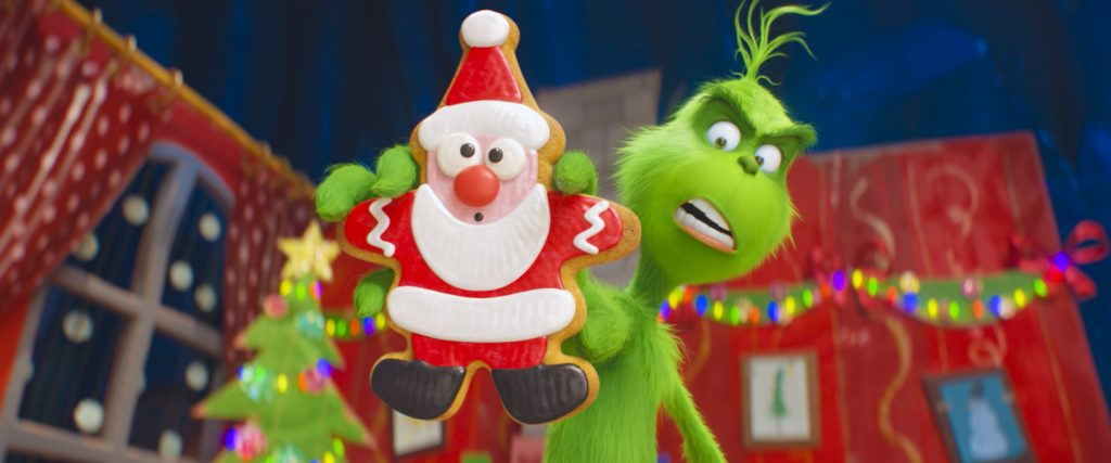 The Grinch with Santa Cookie